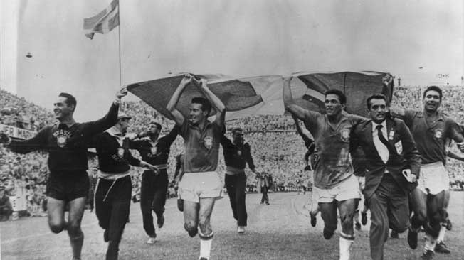 Brazil's players parade a Swedish flag after their World Cup win at the Råsunda Stadium in Solna.