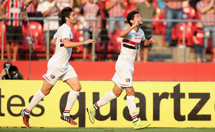 Paulo Henrique Ganso (right) of São Paulo, celebrates with Kaká after scoring a goal against his old club Santos.