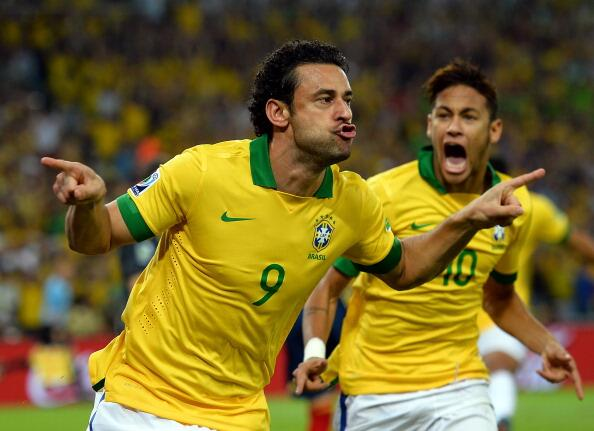 Fred Scores for Brazil against Spain at the Confederations Cup, as Neymar celebrates.