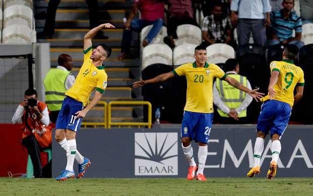 Boschilia, Kenedy, and Mosquite celebrate Brazil's second goal.